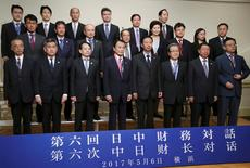 Chinese Finance Minister Xiao Jie, front row fourth from right, Japanese Finance Minister Taro Aso, front row fourth from left, pose for a photo with Japan's and China's executives of Finance Ministry and Central Bank during their bilateral meeting, on the sideline of Asian Development Bank annual meeting, in Yokohama, near Tokyo, Saturday, May 6, 2017. REUTERS/Koji Sasahara/Pool