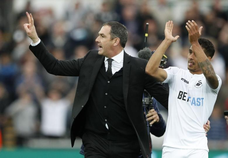 Britain Soccer Football - Swansea City v Everton - Premier League - Liberty Stadium - 6/5/17 Swansea City manager Paul Clement and Kyle Naughton celebrate at the end of the match Action Images via Reuters / John Sibley Livepic