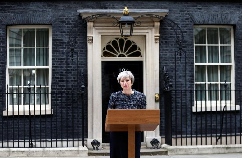 Britain's Prime Minister Theresa May speaks outside 10 Downing Street after traveling to Buckingham Palace to visit Queen Elizabeth after Parliament was dissolved ahead of the general election, in London May 3, 2017. REUTERS/Neil Hall