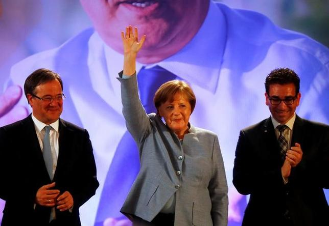 Bonn, Germany - 04/05/2017 - German Chancellor Angela Merkel waves next to CDU's top candidate Armin Laschet (L) at an election rally. REUTERS/Wolfgang Rattay/Files