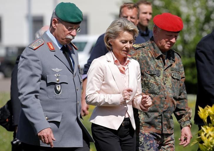 German Defence Minister Ursula von der Leyen (C) walks with General Joerg Vollmer, General Inspector of the German Land Army (L), and General Volker Wieker, Inspector General of Germany's Armed Forces in Bundeswehr, during her visit at the 291st fighter squadron based at the ''Quartier Leclerc'', a military facility for French and German military units in Illkirch-Graffenstaden near Strasbourg, France May 3, 2017. REUTERS/Vincent Kessler