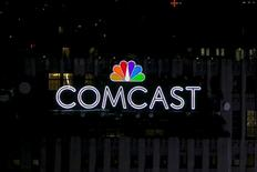 The NBC and Comcast logo are displayed on top of 30 Rockefeller Plaza, formerly known as the GE building, in midtown Manhattan in New York July 1, 2015.   REUTERS/Brendan McDermid/File Photo