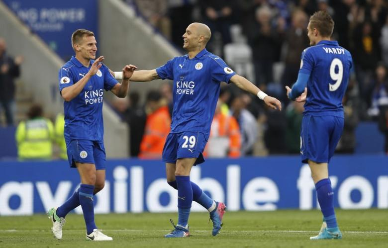 Britain Soccer Football - Leicester City v Watford - Premier League - King Power Stadium - 6/5/17 Leicester City's Marc Albrighton celebrates scoring their third goal with Jamie Vardy and Yohan Benalouane Action Images via Reuters / Carl Recine Livepic
