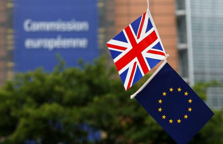 A British Union flag and an European Union flag are seen flying outside the European Commission headquarters in Brussels