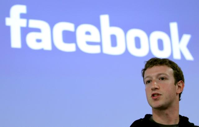 FILE PHOTO: Facebook CEO Mark Zuckerberg speaks during a news conference at Facebook headquarters in Palo Alto, California May 26, 2010.  REUTERS/Robert Galbraith/File Photo