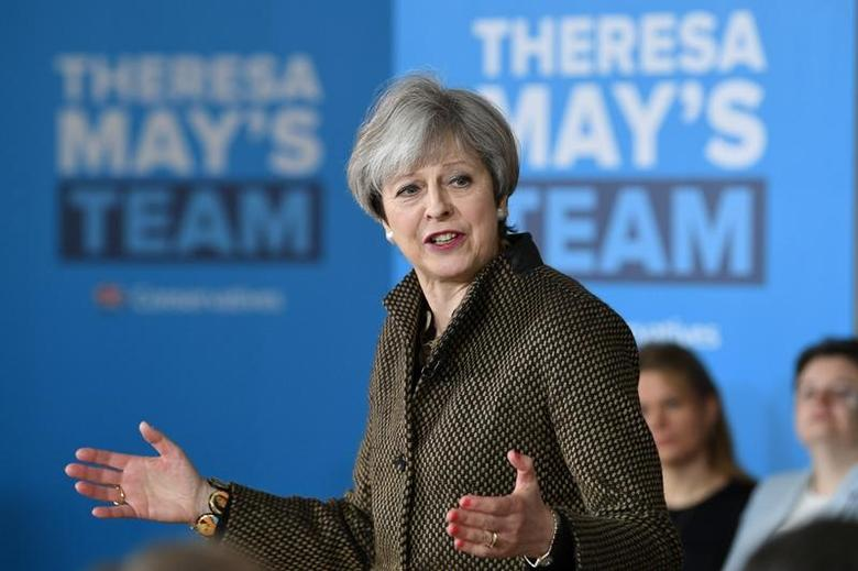 Britain's Prime Minister Theresa May addresses Conservative parliamentary candidates for London and the south east at the Dhamecha Lohana Centre in Harrow, north west London,  May 8, 2017.REUTERS/Stefan Rousseau/Pool