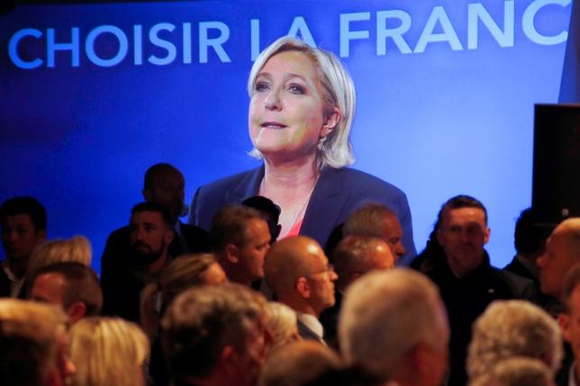 Marine Le Pen, French National Front (FN) political party candidate for French 2017 presidential election, is seen on a screen while conceding defeat at the Chalet du Lac in the Bois de Vincennes in Paris after the second round of 2017 French presidential election, France, May 7, 2017.    REUTERS/Charles Platiau