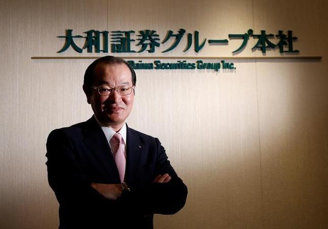 5月2日、大和証券グループ本社の中田誠司社長・最高経営責任者(写真)はロイターとのインタビューで、企業のM&Aアドバイザリー業務を強化するため、米国でM&Aバンカーを大幅に増強する方針を示した。同社の本社で撮影(2017年 ロイター/Toru Hanai)