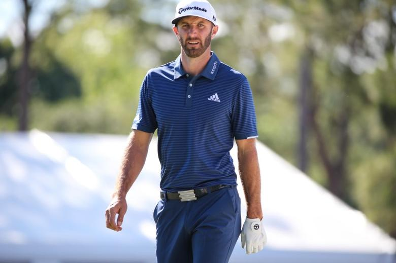 May 7, 2017; Wilmington, NC, USA; Dustin Johnson  walks onto the 18th green with a chance for the lead during the final round of the Wells Fargo Championship golf tournament  at Eagle Point Golf Club. Mandatory Credit: Jim Dedmon