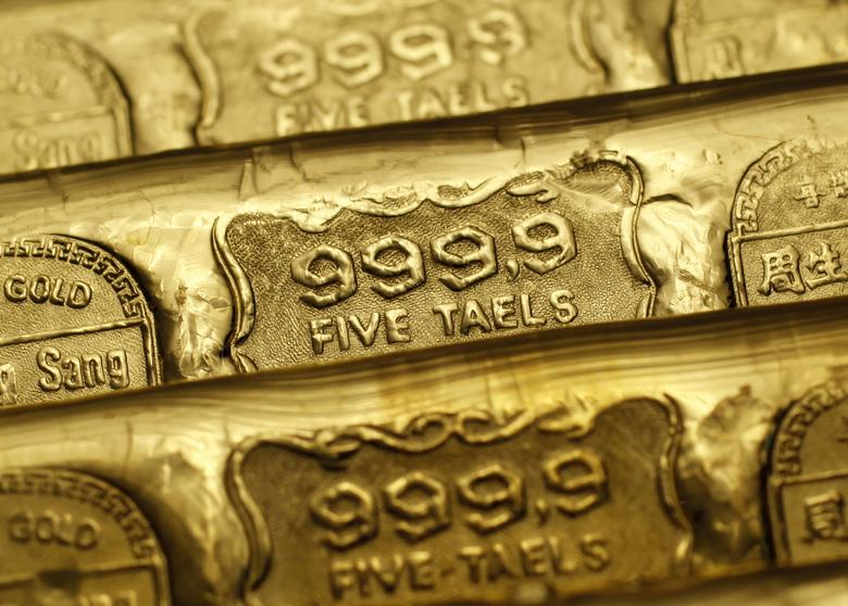 FILE PHOTO: Five-tael (6.65 ounces or 190 grams) gold bars are seen at a jewellery store in Hong Kong in this August 11, 2011 illustration photo. REUTERS/Bobby Yip/File Photo