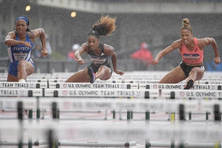 Jul 8, 2016; Eugene, OR, USA; Jasmine Camacho-Quinn (left) and Keni Harrison (middle) and Queen Harrison (right) compete during the women's 100m hurdles semifinals in the 2016 U.S. Olympic track and field team trials at Hayward Field.  Kirby Lee-USA TODAY Sports