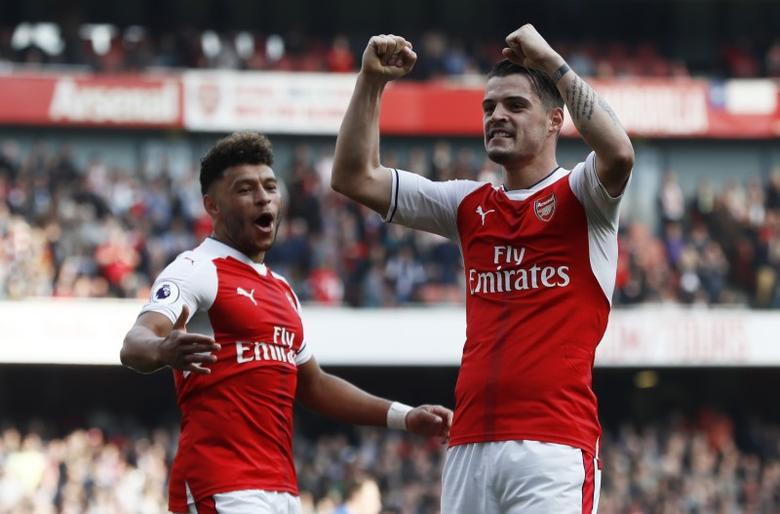 Britain Soccer Football - Arsenal v Manchester United - Premier League - Emirates Stadium - 7/5/17 Arsenal's Granit Xhaka celebrates scoring their first goal with Alex Oxlade-Chamberlain  Reuters / Stefan Wermuth Livepic