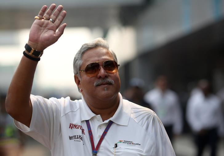 FILE PHOTO: Force India team principal Vijay Mallya waves in the paddock during the third practice session of the Indian F1 Grand Prix at the Buddh International Circuit in Greater Noida, on the outskirts of New Delhi, October 27, 2012.  REUTERS/Ahmad Masood/File Photo