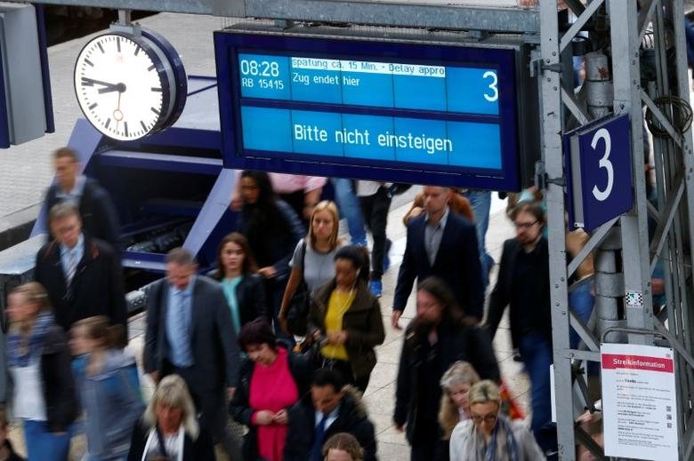 FILE PHOTO:  People walk under a sign reading 'Please do not board' at the main train station in Frankfurt, Germany, May 5, 2015.    REUTERS/Ralph Orlowski/File Photo