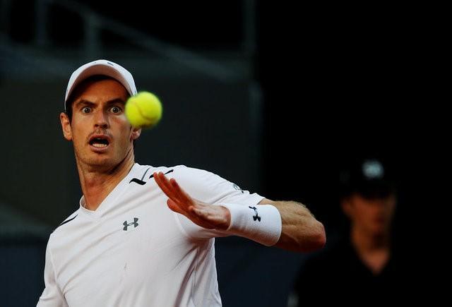 Tennis - ATP 1000 Masters - Madrid Open - Andy Murray of Britain v Marius Copil of Romania  - Madrid, Spain - 9/5/17 - Murray eyes the ball. REUTERS/Susana Vera