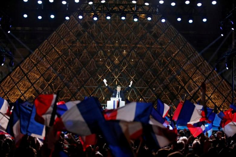French President-elect Emmanuel Macron celebrates on the stage at his victory rally near the Louvre in Paris. REUTERS/Christian Hartmann