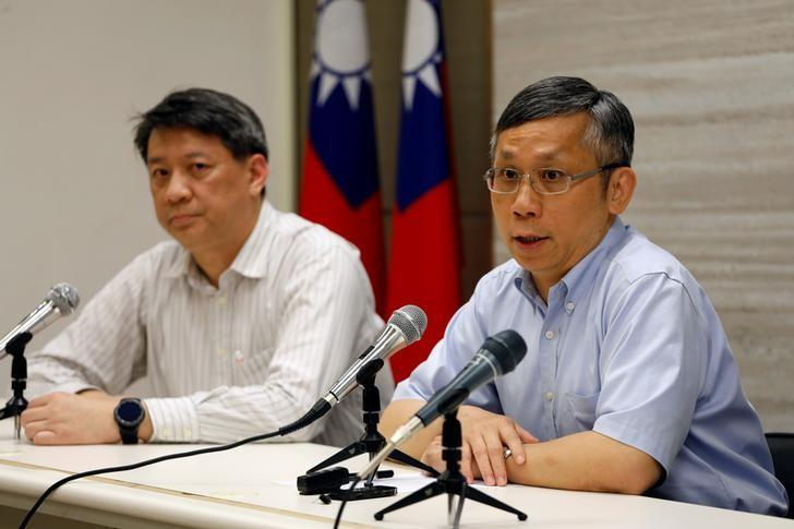 Taiwan's Ministry of Health and Welfare's, Office of International Cooperation director, Hsu Ming-hui (R), talks during a news conference on how Taiwan would react if it is not invited to the World Health Assembly (WHA), in Taipei, Taiwan May 8, 2017. REUTERS/Tyrone Siu
