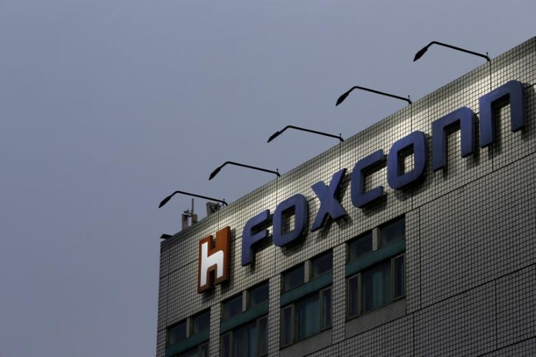 FILE PHOTO: The logo of Foxconn, the trading name of Hon Hai Precision Industry, is seen on top of the company's headquarters in New Taipei City, Taiwan March 29, 2016. REUTERS/Tyrone Siu/File Photo