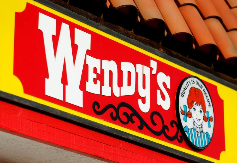 FILE PHOTO: A Wendy's sign and logo are shown at one of the company's restaurant in Encinitas, California May 10, 2016 .  REUTERS/Mike Blake/File Photo