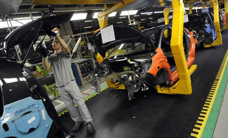 An employee works on a Citroen C3 Picasso on a production line at the PSA Peugeot Citroen Slovakia plant in Trnava December 15, 2010. REUTERS/Radovan Stoklasa