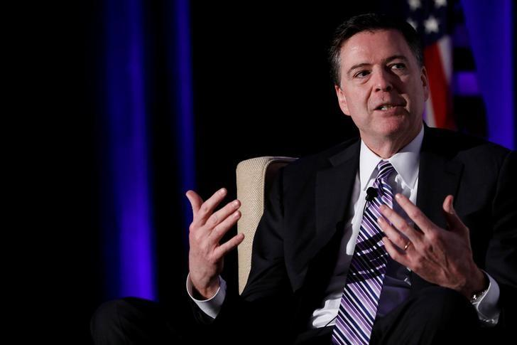 FILE PHOTO: Federal Bureau of Investigation Director James Comey speaks at the Intelligence National Security Alliance Leadership Dinner at the Hilton Mark Center in Alexandria, Virginia, U.S., March 29, 2017.  REUTERS/Aaron P. Bernstein/Files