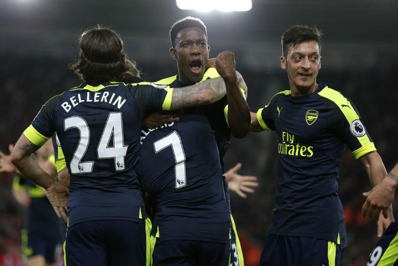 Britain Football Soccer - Southampton v Arsenal - Premier League - St Mary's Stadium - 10/5/17 Arsenal's Alexis Sanchez celebrates scoring their first goal with Danny Welbeck and team mates Action Images via Reuters / Andrew Couldridge Livepic EDITORIAL USE ONLY. No use with unauthorized audio, video, data, fixture lists, club/league logos or ''live'' services. Online in-match use limited to 45 images, no video emulation. No use in betting, games or single club/league/player publications.  Please contact your account representative for further details.