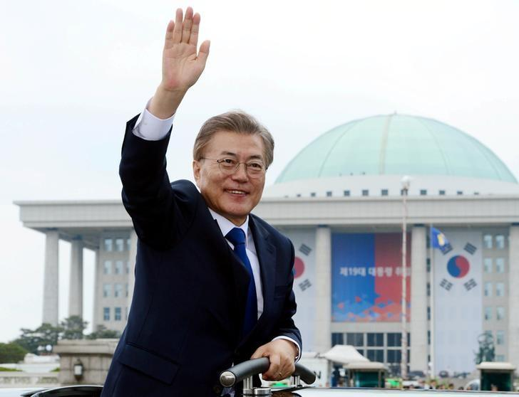 South Korean President Moon Jae-in waves as he leaves the National Cemetery after inaugural ceremony in Seoul, South Korea May 10, 2017. Yonhap via REUTERS/Files