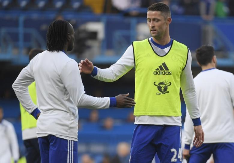Britain Football Soccer - Chelsea v Middlesbrough - Premier League - Stamford Bridge - 8/5/17 Chelsea's Gary Cahill and Victor Moses warm up before the game Reuters / Toby Melville Livepic