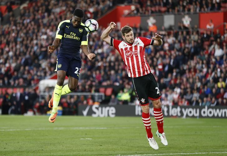 Britain Football Soccer - Southampton v Arsenal - Premier League - St Mary's Stadium - 10/5/17 Arsenal's Danny Welbeck in action with Southampton's Jack Stephens  Reuters / Stefan Wermuth Livepic