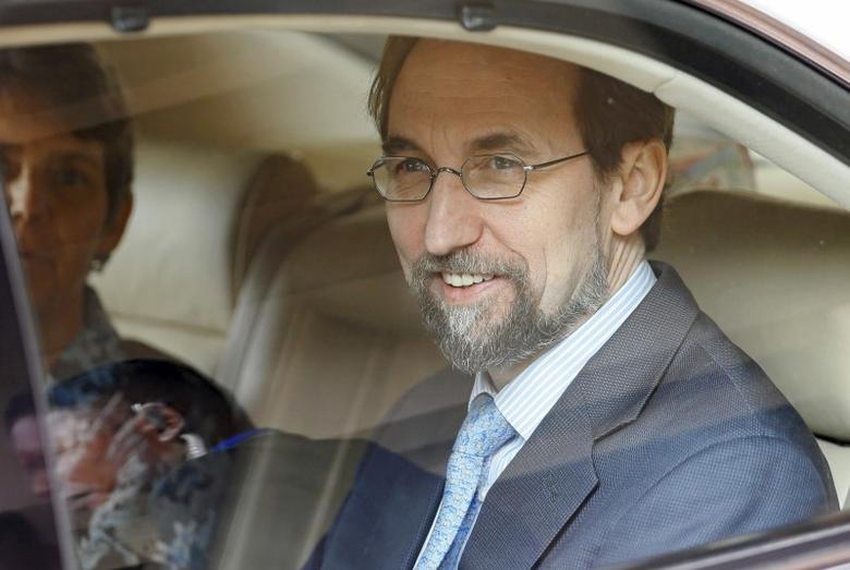 United Nations (U.N.) High Commissioner for Human Rights Zeid Ra'ad Al Hussein (R) smiles after meeting the media while leaving his hotel to meet Sri Lankan politicians and diplomats in Colombo February 6, 2016. REUTERS/Dinuka Liyanawatte/Files