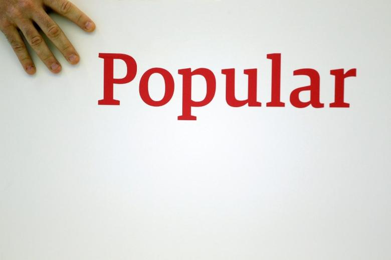 FILE PHOTO: Spain's Banco Popular logo is seen during the bank's results presentation in Madrid, Spain, July 29, 2016. REUTERS/Juan Medina/File Photo