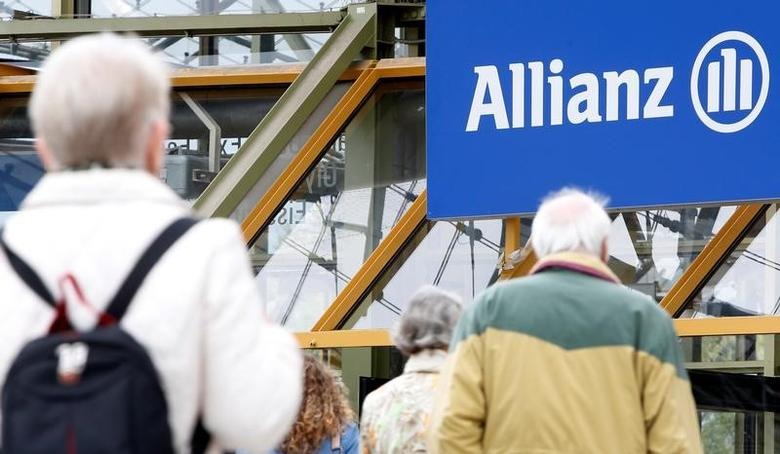 People arrive for the annual shareholders' meeting of Europe's biggest insurer Allianz SE, in Munich, Germany May 3, 2017. REUTERS/Michaela Rehle