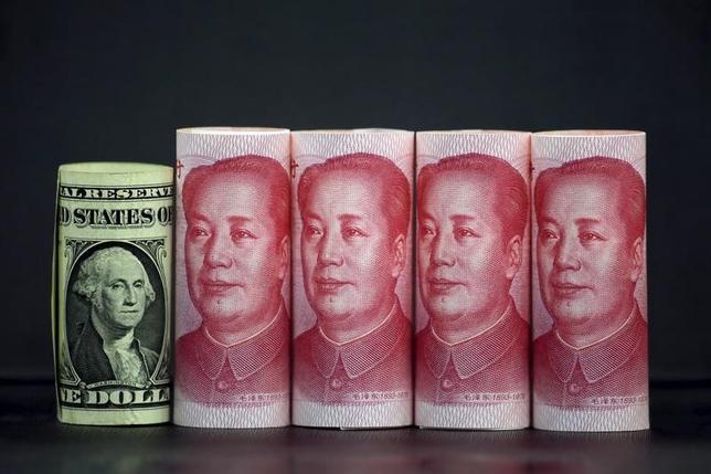 5月11日、中国専門のプライベートエクイティ(PE)、Aキャピタルが公表したデータによると、昨年の中国の対外直接投資はサービスや工業の分野で急増した。写真は中国・北京で昨年1月撮影(2017年 ロイター/Jason Lee)