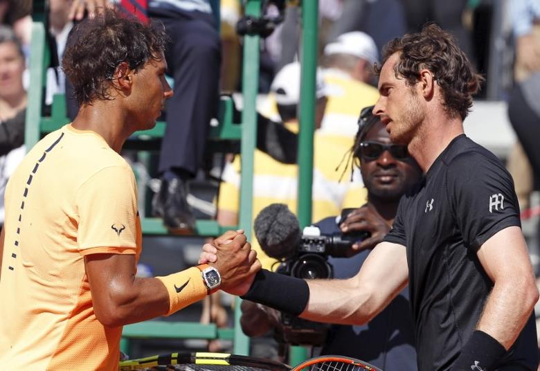 FILE PHOTO: Tennis - Monte Carlo Masters - Monaco, 16/04/2016. Rafael Nadal of Spain (L) shakes hands with Andy Murray of Britain after match.  REUTERS/Eric Gaillard