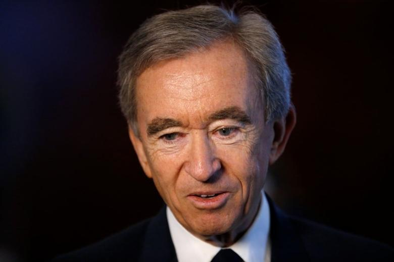 Chairman and CEO of Luxury goods group LVMH Bernard Arnault talks to journalists after a news conference, to announce a deal to simplify Christian Dior business structure, in Paris, France, April 25, 2017. REUTERS/Stephane Mahe