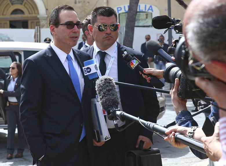 U.S. Secretary of the Treasury Steven Mnuchin talks with reporters as he arrives for the G7 Financial ministers meeting in the southern Italian city of Bari, Italy, May 12, 2017. REUTERS/Alessandro Bianchi