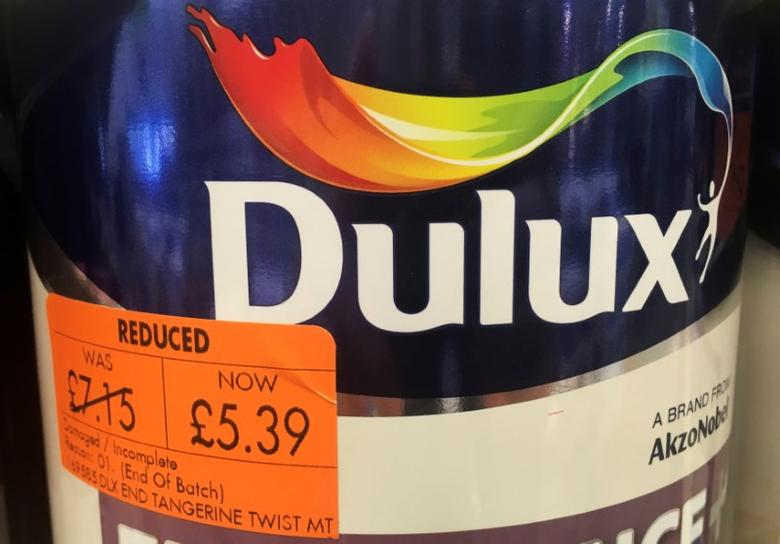 FILE PHOTO: Cans of Dulux paint, an Akzo Nobel brand, are seen on the shelves of a hardware store near Manchester, Britain, April 24, 2017. REUTERS/Phil Noble/File Photo