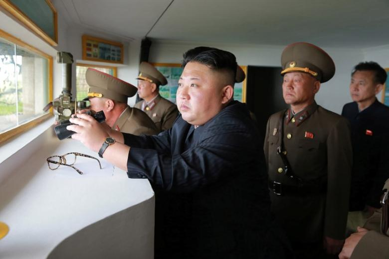 North Korean leader Kim Jong Un inspects the defence detachment on Jangjae Islet and the Hero Defence Detachment on Mu Islet located in the southernmost part of the waters off the southwest front, in this undated photo released by North Korea's Korean Central News Agency (KCNA) on May 5, 2017. KCNA/ via REUTERS