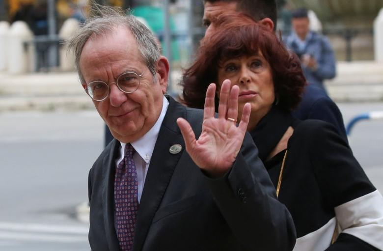 Italy's Finance Minister Pier Carlo Padoan and his wife arrive at the Petruzzelli Theatre during a G7 for Financial ministers in the southern Italian city of Bari, Italy May 11, 2017. REUTERS/Alessandro Bianchi