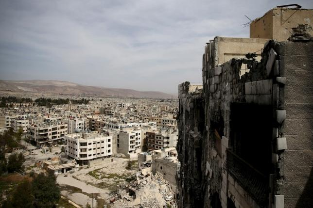 FILE PHOTO: A general view shows damaged buildings as seen from the rebel held Qaboun neighborhood of Damascus, Syria March 13, 2016. Picture taken March 13, 2016. REUTERS/Bassam Khabieh