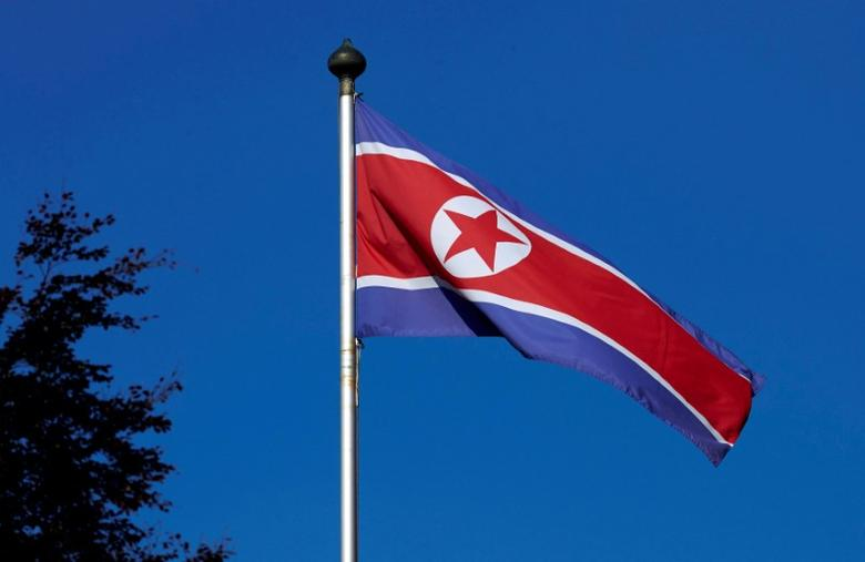 FILE PHOTO: A North Korean flag flies on a mast at the Permanent Mission of North Korea in Geneva October 2, 2014. REUTERS/Denis Balibouse/File Photo