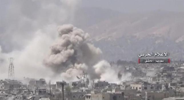 A still image taken from a video uploaded by the Syrian Army on May 13, 2017 shows smoke rising from Qaboun, on the edge of the capital Damascus, Syria. SYRIAN ARMY HANDOUT via Reuters TV