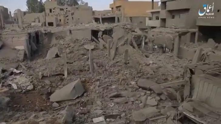 FILE PHOTO - A still image taken from a video released on the internet by Islamic State-affiliated Amaq News Agency, on April 18, 2017, purports to show the aftermath, said to be in al-Bukamal town, in Deir al-Zor province, after air strikes thought to have been directed by planes from a U.S.-led military coalition, Syria. Social Media Website via Reuters TV