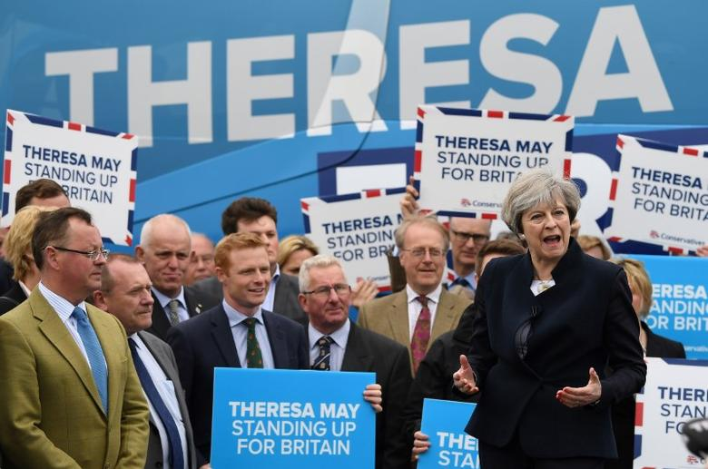 Britain's Prime Minister Theresa May addresses supporters and members of the media in front of the Conservative party's election campaign bus at an airfield north of Newcastle, Britain May 12, 2017. REUTERS/Justin Tallis/Pool