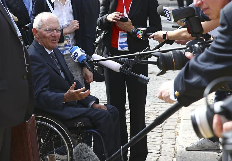 German Finance Minister Wolfgang Schaeuble talks with reporters as he arrives for the G7 Financial ministers meeting in the southern Italian city of Bari, Italy, May 12, 2017. REUTERS/Alessandro Bianchi