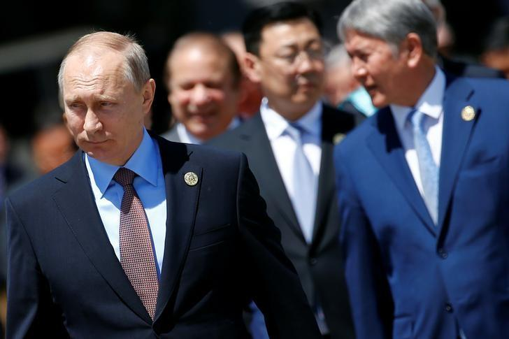 Russian President Vladimir Putin and other leaders arrive for a family photo during the Belt and Road Forum at meeting's venue on Yanqi Lake just outside Beijing, China, May 15, 2017. REUTERS/Damir Sagolj