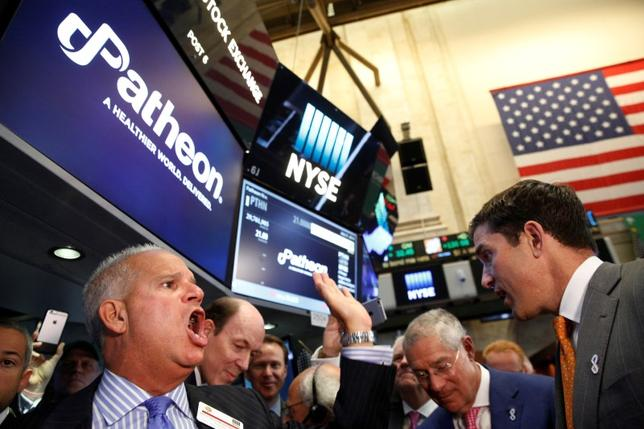 FILE PHOTO: Floor governor Rudy Mass (L) closes the price to begin trading of Patheon NV, during the  company's IPO on the floor of the New York Stock Exchange (NYSE) in New York City, U.S., July 21, 2016.  REUTERS/Brendan McDermid