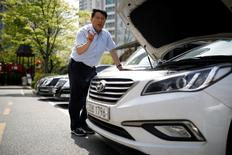 Kim Gwang-ho speaks as he checks his Hyundai Motor's car during an interview with Reuters in Yongin, South Korea, April 19, 2017. Picture taken on April 19, 2017.  REUTERS/Kim Hong-Ji
