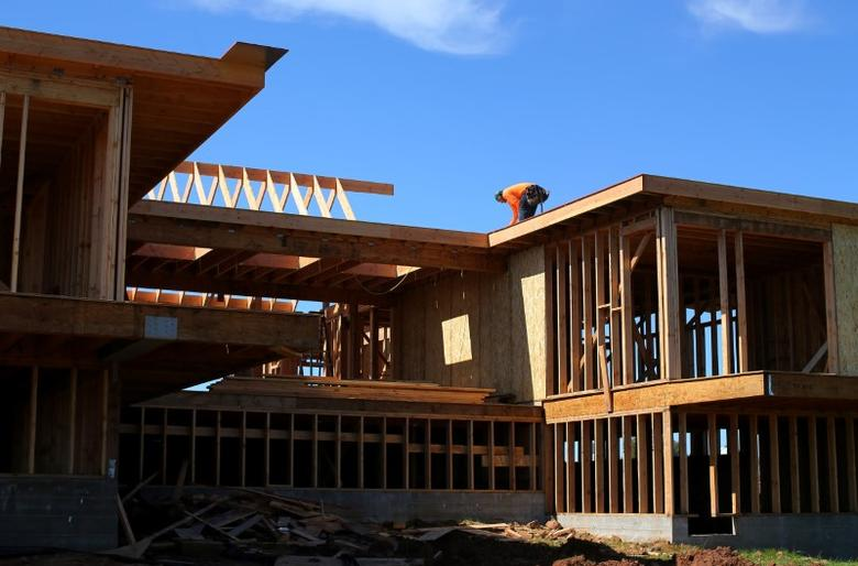 FILE PHOTO: Construction workers build a single family home in San Diego, California, U.S. February 15, 2017. Picture taken February 15, 2017.