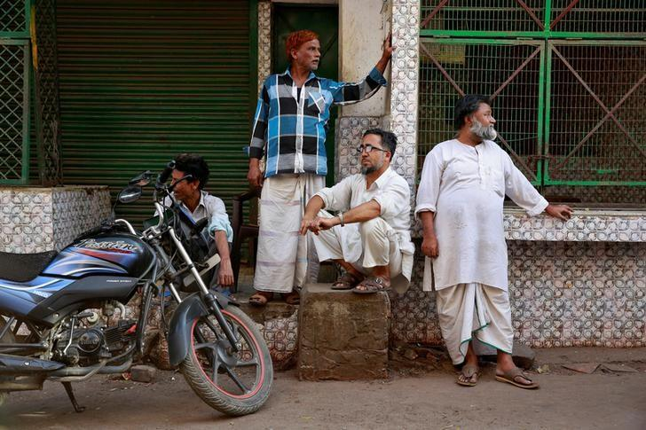 Butchers from the Qureshi community gather outside meat shops ordered to close, following regulations imposed by newly elected Uttar Pradesh State Chief Minister, Yogi Adityanath, in Lucknow, India, April 4, 2017. REUTERS/Cathal McNaughton/Files
